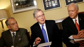 (L-R) Sen. Chuck Grassley (R-IA), Senate Majority Leader Mitch McConnell, Sen. Orrin Hatch introduce the Republican tax reform plan at the U.S. Capitol in Washington, U.S., November 9, 2017. REUTERS/Aaron P. Bernstein
