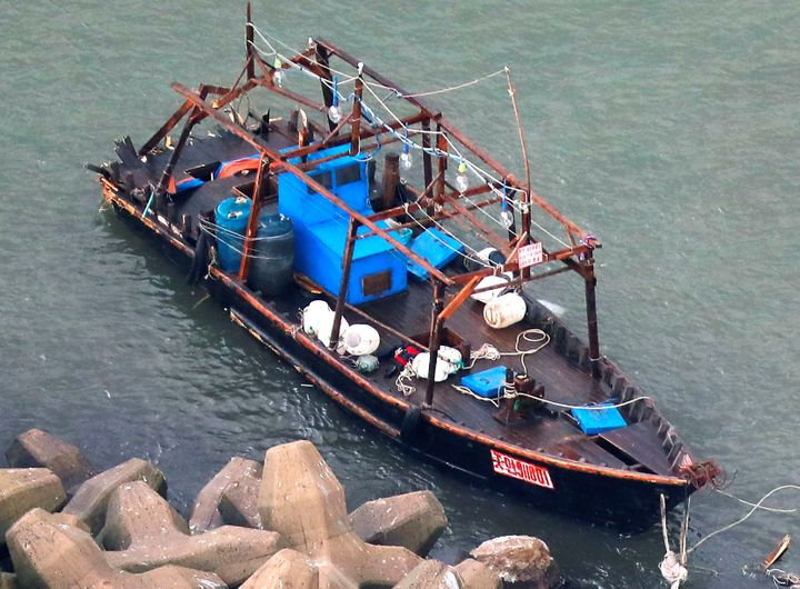 Eight men who said they are fishermen from North Korea were found with this boat on Friday along northern Japan's coast.