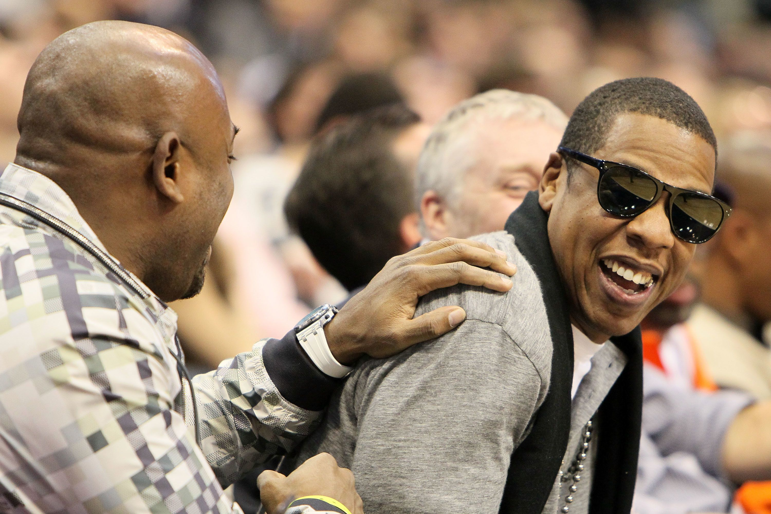DALLAS - FEBRUARY 13:  Producer/rapper Shawn 'Jay-Z' Carter (R) laughs during the Haier Shooting Stars Competition on All-Star Saturday Night, part of 2010 NBA All-Star Weekend at American Airlines Center on February 13, 2010 in Dallas, Texas. NOTE TO USER: User expressly acknowledges and agrees that, by downloading and or using this photograph, User is consenting to the terms and conditions of the Getty Images License Agreement.  (Photo by Jed Jacobsohn/Getty Images)