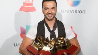 "18th Latin Grammy Awards – Photo Room – Las Vegas, Nevada, U.S., 16/11/2017 – Luis Fonsi holds his awards for Song of the Year, Record of the Year and Best Long Form Music Video for ""Despacito"" and Best Urban Fusion/Performance for  ""Despacito (Remix)"". REUTERS/Steve Marcus"