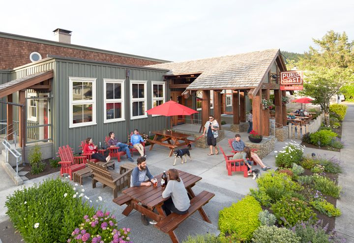 <p>Locals and visitors relaxing at Public Coast Brewery.</p>