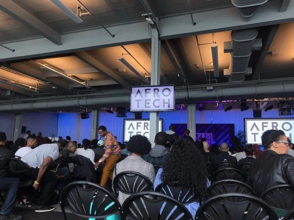 Conference attendees gather for the opening remarks by Blavity founder Morgan DeBaun