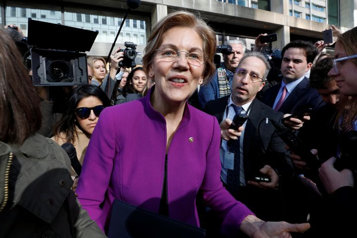 Sen. Elizabeth Warren (D-Mass.) speaks to reporters after a rally in support of the Consumer Financial Protection Bureau's in