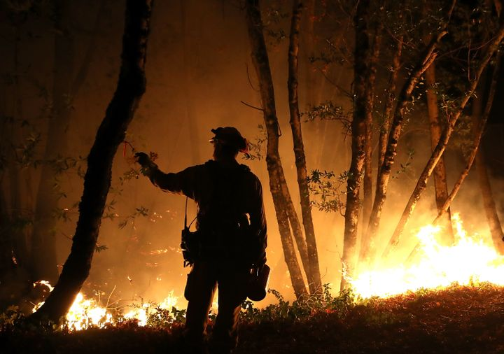 Firefighter Brandon Tolp monitors an operation while battling the Tubbs fire on Oct. 12.