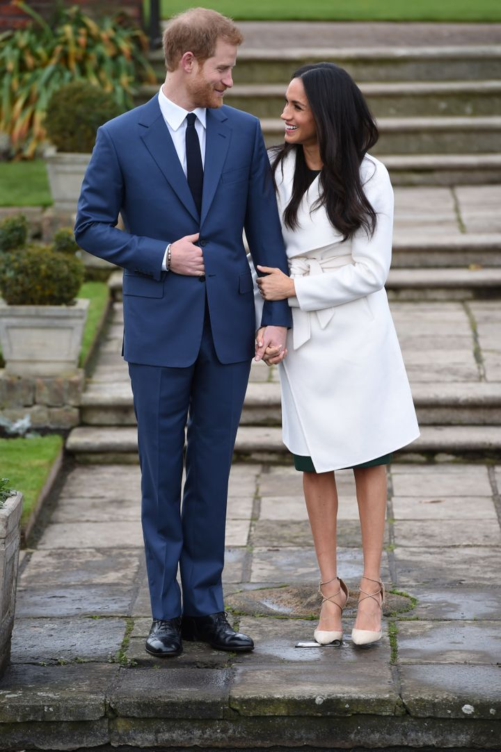 Britain's Prince Harry poses with Meghan Markle in the Sunken Garden of Kensington Palace, London, on Nov. 27, 2017.