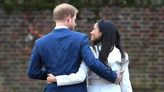 LONDON, ENGLAND - NOVEMBER 27: Prince Harry and actress Meghan Markle attend an official photocall to announce their engagement at The Sunken Gardens at Kensington Palace on November 27, 2017 in London, England. Prince Harry and Meghan Markle have been a couple officially since November 2016 and are due to marry in Spring 2018on November 27, 2017 in London, England. (Photo by Steve Back/Getty Images)
