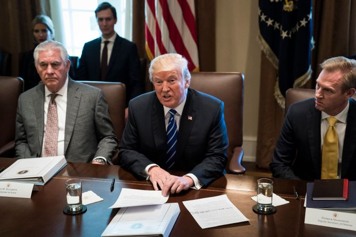 President Donald Trump, seen between Secretary of State Rex Tillerson and Deputy Secretary of Defense Patrick Shanahan, annou