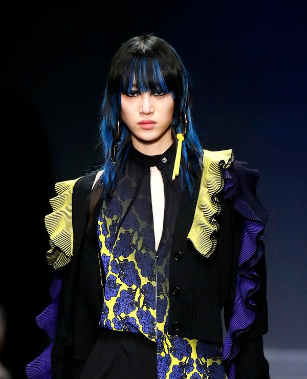 Just when you thought colorful hair was on the way out, it popped up again on the runway at Versace (pictured), <a href=
