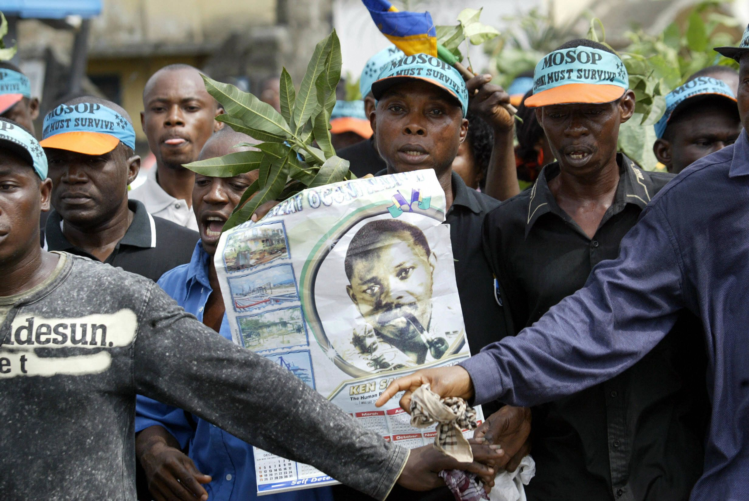 Ogoni activists carrying a poster of Ken Saro-Wiwa march on the Port Harcourt highway.