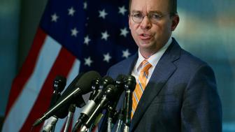 Office of Management and Budget (OMB) Director Mick Mulvaney speaks to the media at the U.S. Consumer Financial Protection Bureau (CFPB), where he began work earlier in the day after being named acting director by U.S. President Donald Trump in Washington November 27, 2017. A day earlier, Mulvaney was sued by Leandra English, a senior CFPB official who claims that she is the agency's rightful leader after former director Richard Cordray promoted English late last week in a final move before he stepped aside. REUTERS/Joshua Roberts