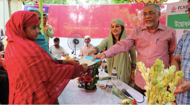Moushumi Khan (in green) at a Charitable Activities event, the Jeebika - Livelihood and Human Development program, where fami