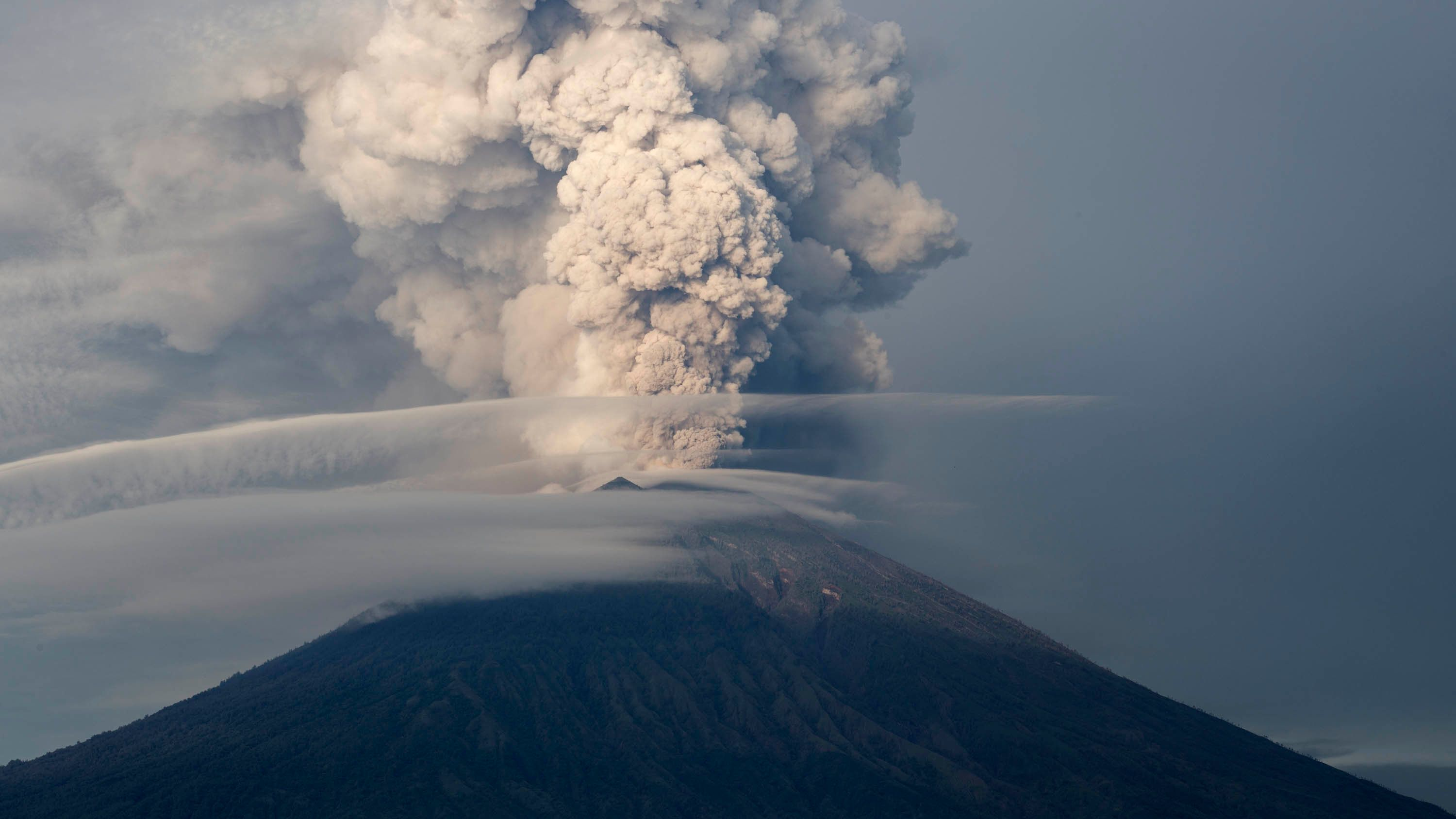 Mount Agung's eruptions have already covered some areas of Bali in ash, and the danger level is at its highest.