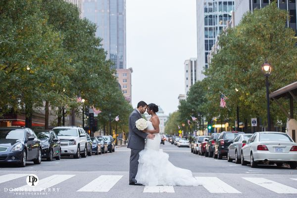 """Marilouise and Frank officially became husband and wife at the Raleigh Marriott City Center in downtown Raleigh, N"