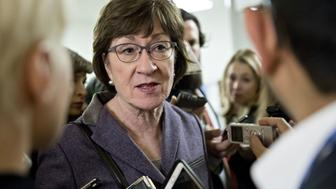 Senator Susan Collins, a Republican from Maine, speaks to members of the media in the basement of the U.S. Capitol after a weekly GOP luncheon meeting in Washington, D.C., U.S., on Tuesday, Nov. 28, 2017. The Senate Budget Committee sent Republicans massive tax-cut bill to the full Senate for a marathon debate and vote as early as Thursday -- a major step toward getting a plan enacted by the end of this year. Photographer: Andrew Harrer/Bloomberg via Getty Images