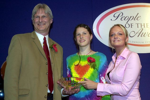 Josie Russell and her father, Dr Shaun, being presented with a People of the Year award in
