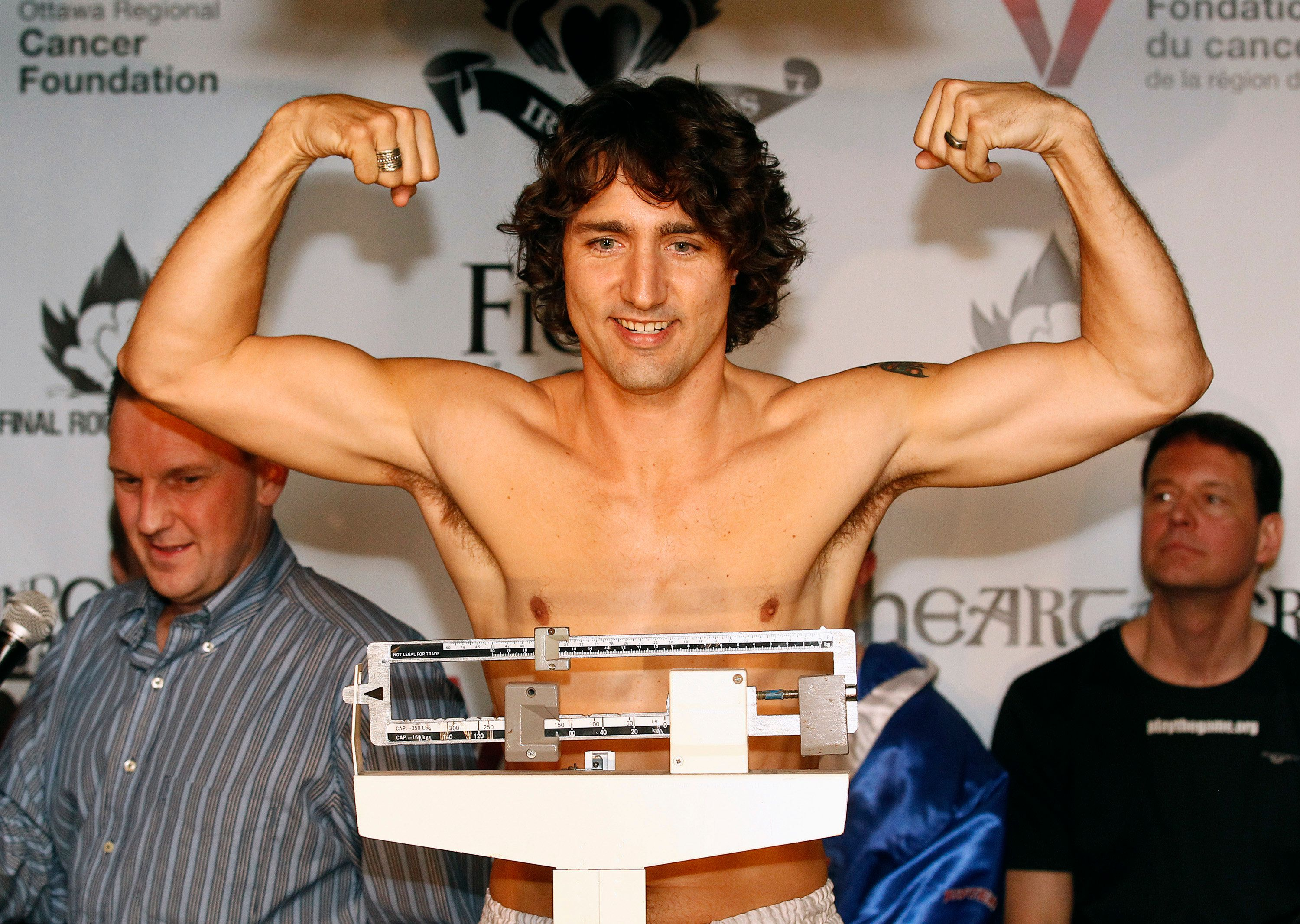 Liberal Member of Parliament Justin Trudeau gestures while weighing-in for a charity boxing match in Ottawa March 28, 2012. Trudeau and Conservative Senator Patrick Brazeau will face-off against each other March 31. REUTERS/Chris Wattie (CANADA - Tags: POLITICS SPORT BOXING)