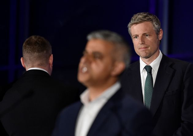 Paul Golding (left) turns his back as Sadiq Khan (centre) gives a speech having just been elected mayor...