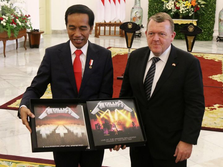 "Indonesian President Joko Widodo, left, received a box set of Metallica's ""Master of Puppets"" from Danish Prime Minister Lars"