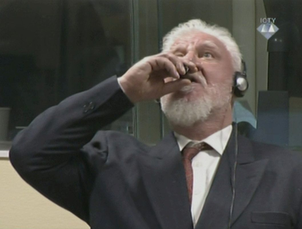 A wartime commander of Bosnian Croat forces, Slobodan Praljak, is seen during a hearing at the U.N. war crimes tribunal in the Hague, Netherlands, November 29, 2017. ICTY via REUTERS TV ATTENTION EDITORS - THIS IMAGE WAS PROVIDED BY A THIRD PARTY.