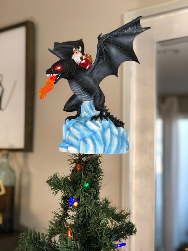"Stars on trees are so 2016. This ""Game of Thrones"" <a href=""https://gorillagoodies.com/products/dragon-tree-topper"" targ"