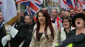 Deputy leader of the far-right organisation Britain First, Jayda Fransen gestures as she participates in a march in central London on April 1, 2017.  / AFP PHOTO / Daniel LEAL-OLIVAS        (Photo credit should read DANIEL LEAL-OLIVAS/AFP/Getty Images)