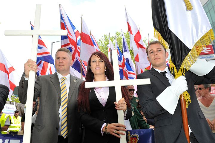 Golding, left, and Fransen, center, join a British First protest march at Bury Park on June 27, 2015, in Luton, England.