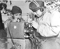 <em>Pfc. Preston Toledo and Pfc. Frank Toledo, Navajo cousins in a Marine artillery regiment in the South Pacific, relay ord