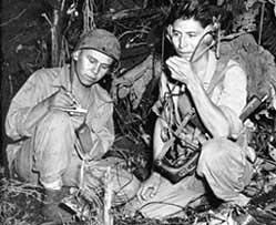 <em>Cpl. Henry Bake, Jr., and Pfc. George H. Kirk, Navajos serving in December 1943 with a Marine Corps signal unit, operate