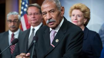 UNITED STATES - SEPTEMBER 27: Rep. John Conyers, D-Mich., speaks at a news conference in the Capitol to call for aid for the Flint water crisis be included in the government funding bill, September 27, 2016. From left, Reps. Bobby Scott, D-Va., Sens. Gary Peters, D-Mich., and Debbie Stabenow, D-Mich., also appear. (Photo By Tom Williams/CQ Roll Call)