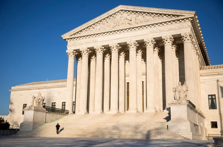 A police officer walks up the steps of the Supreme Court in Washington on March 2, 2015. (REUTERS/Joshua Roberts)