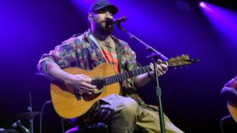 NASHVILLE, TN - NOVEMBER 12:  In this handout photo provided by The Country Rising Fund of The Community Foundation of Middle Tennessee, singer Sam Hunt performs onstage for the Country Rising Benefit Concert at Bridgestone Arena on November 12, 2017 in Nashville, Tennessee.  (Photo by John Shearer/Country Rising/Getty Images)