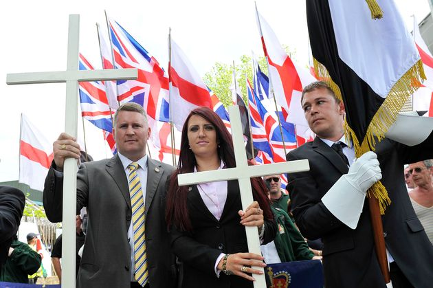Jayda Fransen (center) joins a Britain First protest march on June 27, 2015, in Luton,