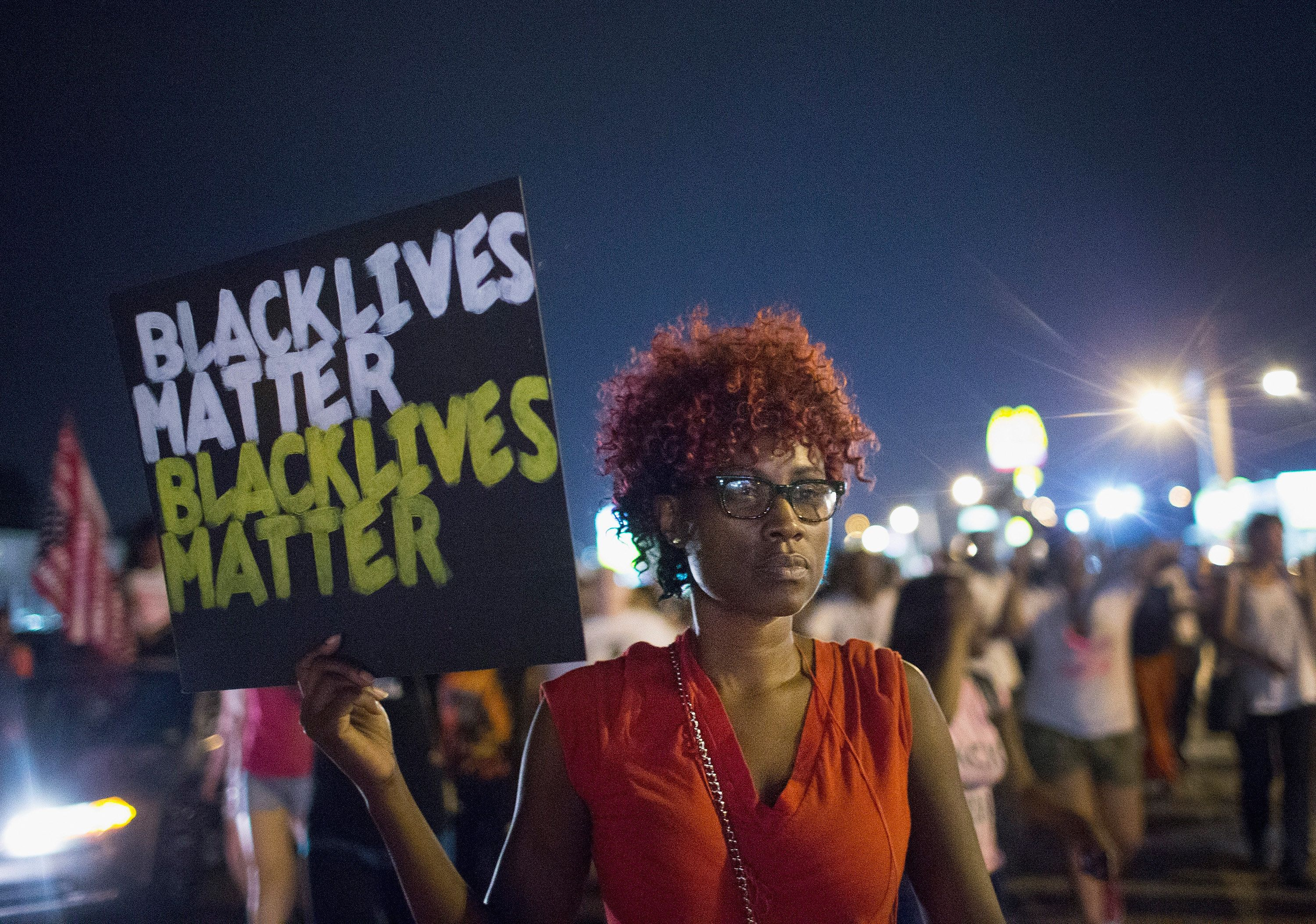 FERGUSON, MO - AUGUST 08:  Demonstrators march to mark the first anniversary of the death of Michael Brown on August 8, 2015 in Ferguson, Missouri. Brown, an unarmed black teenager, was shot and killed by a Ferguson police officer on August 9, 2014. Brown's death sparked months of sometimes violent protests in Ferguson and drew nationwide focus on police treatment of black suspects.  (Photo by Scott Olson/Getty Images)