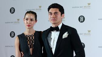 SINGAPORE - NOVEMBER 25:  Henry Golding (R) and Liv Lo attend The Singapore International Film Festival Benefit Dinner Red Carpet at Sands Expo and Convention Centre on November 25, 2017 in Singapore.  (Photo by Suhaimi Abdullah/Getty Images)