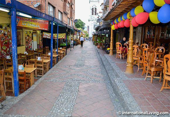 Restaurant-lined alleyway. Sabaneta, Medellin, Colombia.