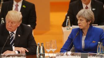HAMBURG, GERMANY - JULY 7:  (RUSSIA OUT)   U.S. President Donald Trump (L) and Britain's Prime Minister Theresa May (R) seen during the plenary session at the G20 Summit on July 7, 2017 in Hamburg, Germany. (Photo by Mikhail Svetlov/Getty Images)