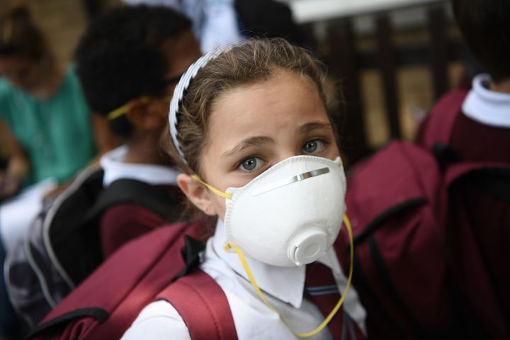 Children at nearby schools wore protective face masks near the burning Grenfell Tower block in West London.