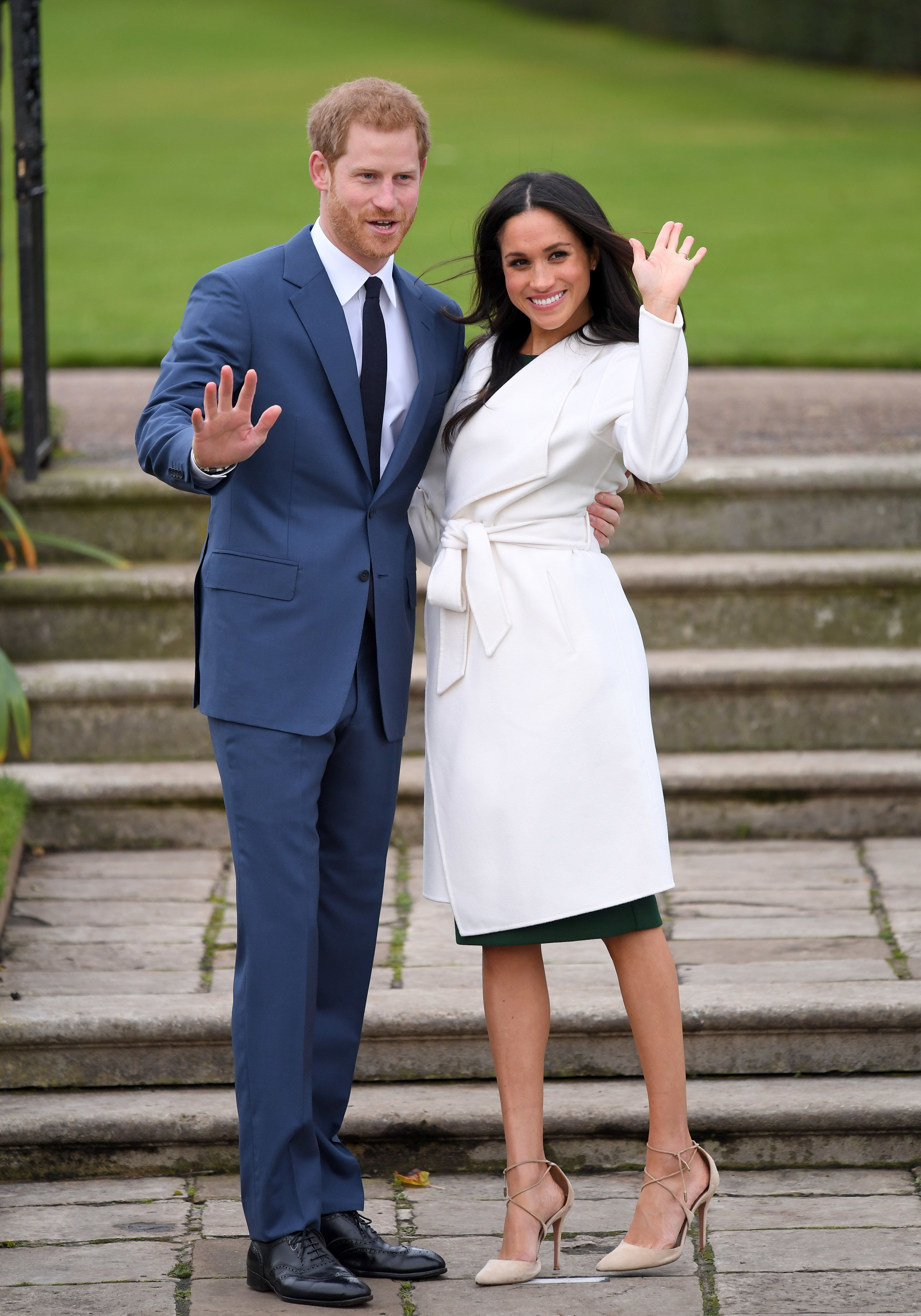 With Prince Harry at an official photocall to announcetheir engagement at The Sunken Gardens at Kensington Palace in Lo