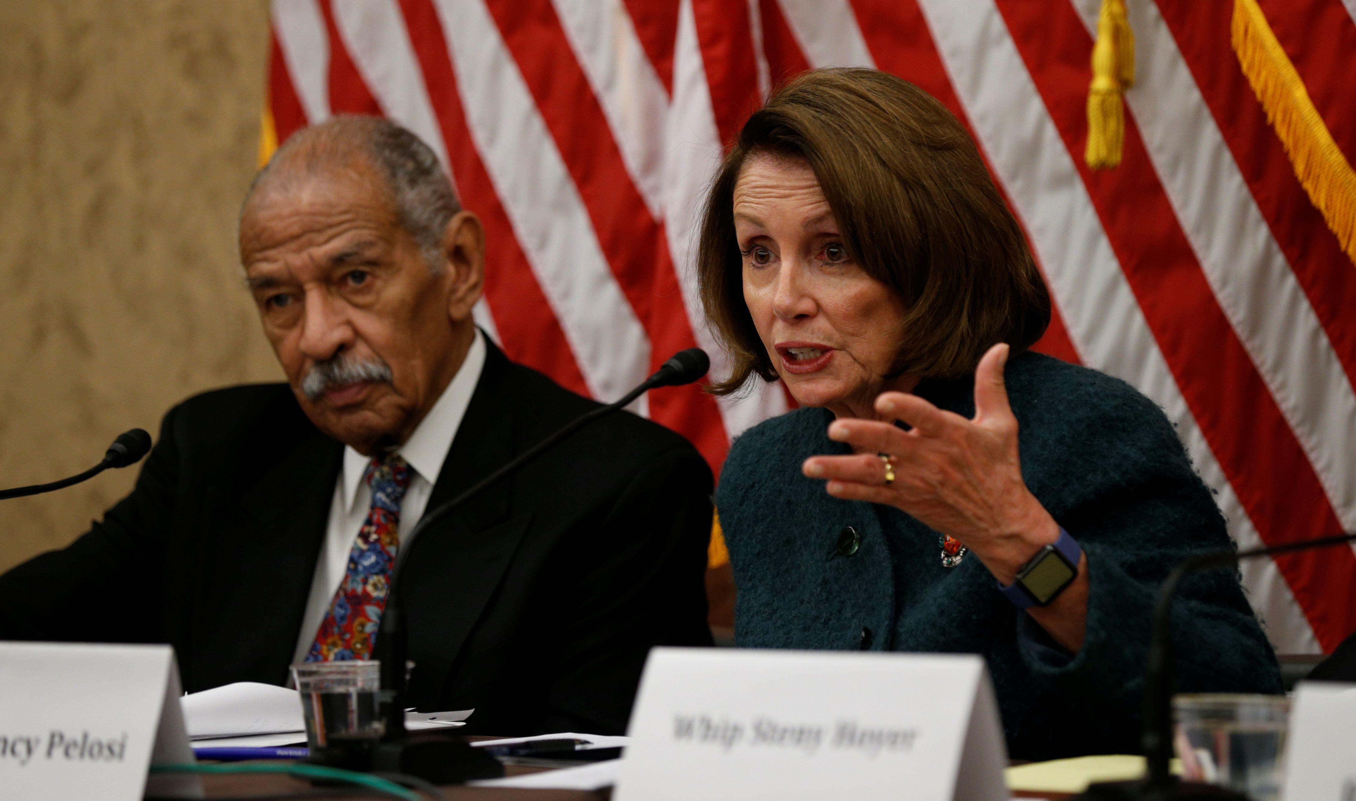 House Minority leader Nancy Pelosi and Rep. John Conyers take part in a discussion panel on President Trump's Muslim and refugee ban in the U.S. Capitol in Washington, U.S., February 2, 2017.  REUTERS/Kevin Lamarque