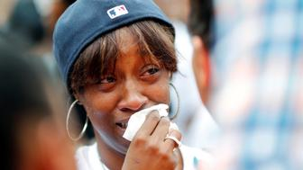 Diamond Reynolds, girlfriend of Philando Castile, weeps as people gather to protest the fatal shooting of Castile by Minneapolis area police during a traffic stop on Wednesday, in St. Paul, Minnesota, U.S., July 7, 2016. REUTERS/Adam Bettcher/File Photo