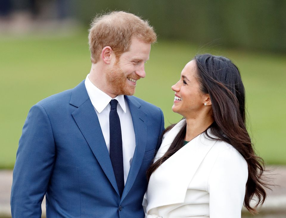 Prince Harry and Meghan Markle attend an official photocall to announce their engagement at The Sunken Gardens, Kensington Pa