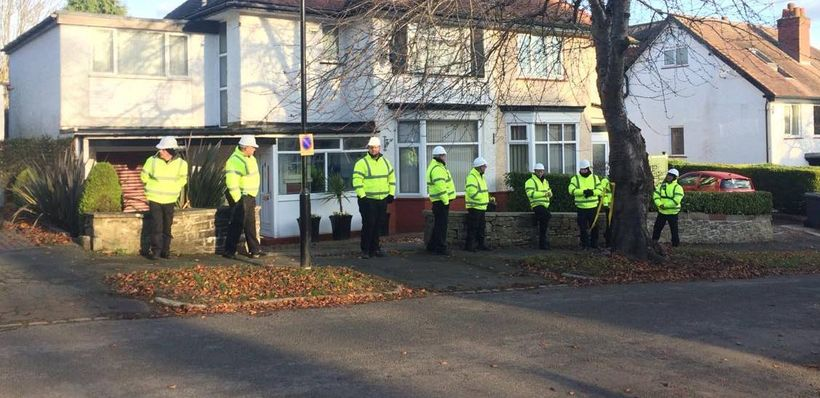 Private army blocking pavement access to allow felling of tree day before Christmas decoration display