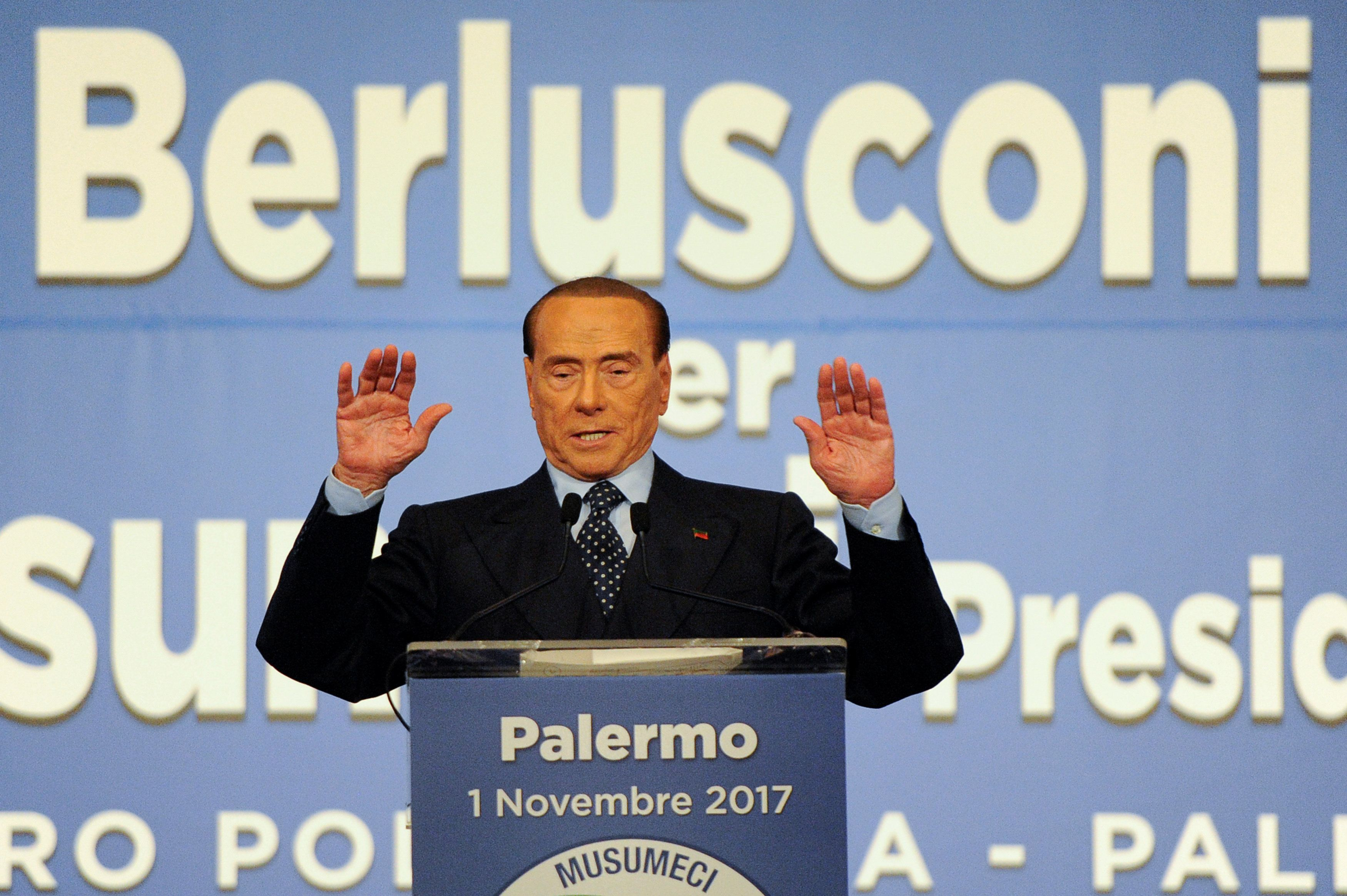 Forza Italia party leader Silvio Berlusconi gestures during a rally for the regional election in Palermo, Italy, November 1, 2017.   REUTERS/Guglielmo Mangiapane