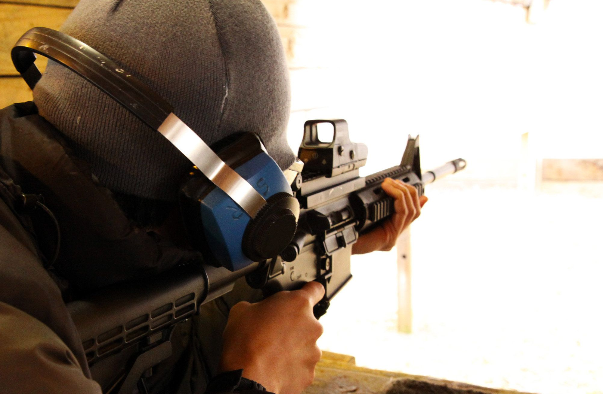 Aiming at the target with the assult rifle in the gun ranch