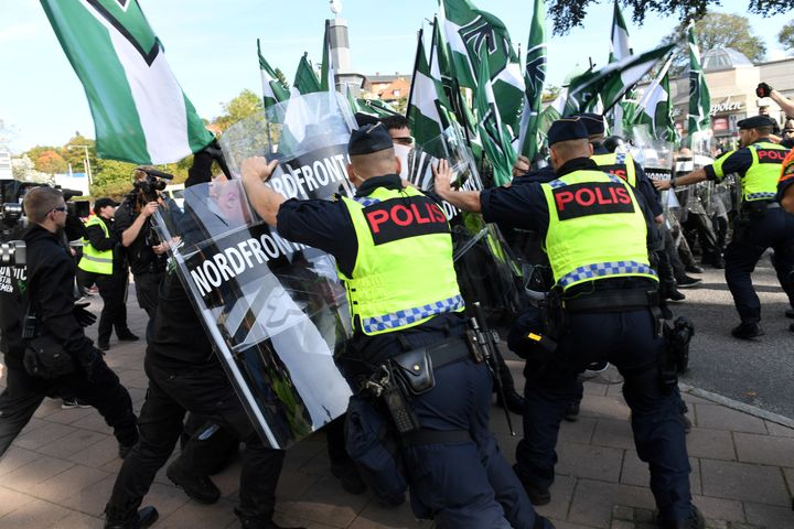 Police stop Nordic Resistance Movement members from walking along a forbidden street during their march in Gothenburg, Sweden