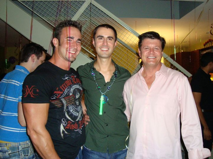John Grove, left, with his brother Brian, center, and father Bob, right, at a party in 2008.