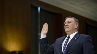 FILE: Representative Mike Pompeo, a Republican from Kansas and Central Intelligence Agency (CIA) director nominee for President-elect Donald Trump, swears in to a Senate Intelligence Committee confirmation hearing in Washington, D.C., U.S., on Thursday, Jan. 12, 2017. The White House is discussing whether to replace Secretary of State Rex Tillerson with CIA Director Mike Pompeo, two White House officials said. Our editors select the best archive images of Pompeo and Tillerson.  Photographer: Andrew Harrer/Bloomberg via Getty Images