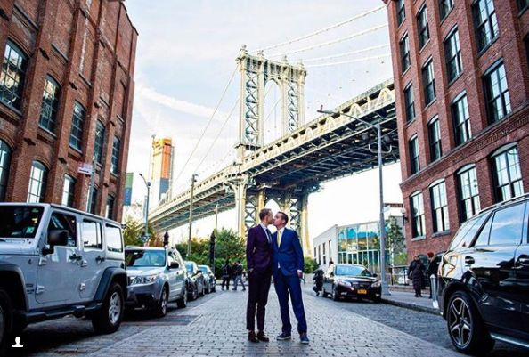"""Photographed my last big wedding for the season with Ezra and Jeremy! Such a fun celebration at The Dumbo Loft."" -- <i>De Nu"