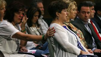 WASHINGTON, DC - JULY 21:  Liz Sullivan (C) mother of Kathryn 'Kate' Steinle who was killed by an illegal immigrant in San Francisco, is comforted while her son Brad Steinle (R) sits nearby during a Senate Judiciary Committee hearing on Capitol Hill, July 21, 2015 in Washington, DC. The committee heard testimony from family members who have had loved ones killed by illegal immigrants.   (Photo by Mark Wilson/Getty Images)