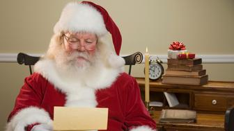 Santa Claus reading mail